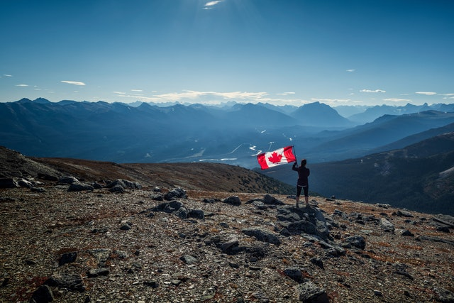 image of person holding canadian flag